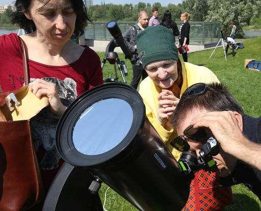 Little Mercury a black dot as it crosses vast face of sun