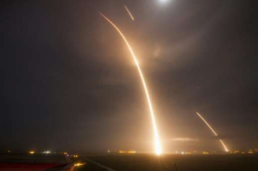 A 9-minute time exposure shows the launch, re-entry, and landing burns of the SpaceX  Falcon 9 rocket