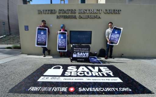 Activists gather in front of the US District Court in Riverside, California, on March 22, 2016, where the Apple v FBI trial was
