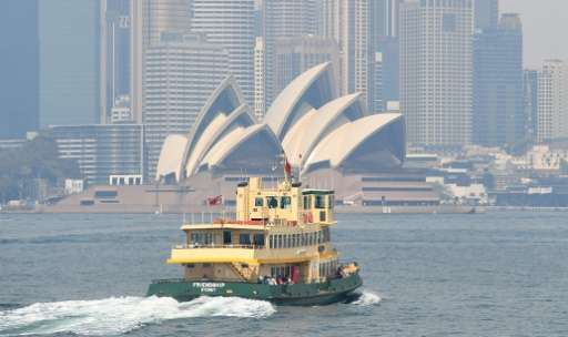 A ferry heads toward Sydney's Circular Quay as the city is shrouded in smoke