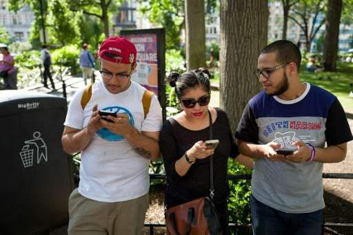 A group of friends play Pokemon Go on their smartphones at Union Square in New York, on July 11, 2016