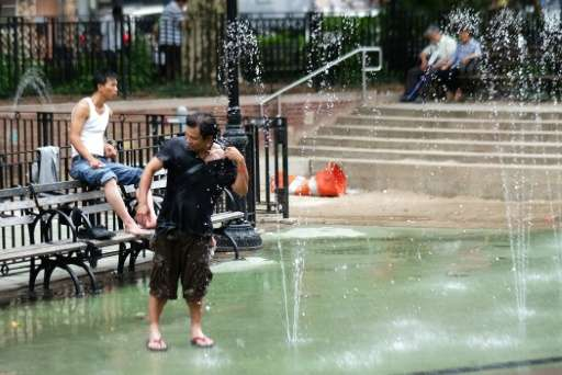 A man cools off at a water fountain in New York in 2015, where the month of May was recorded as the hottest in modern history ac