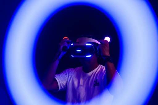 A man plays a Sony Playstation virtual reality game at the annual Ani-Com show in Hong Kong on July 29, 2016
