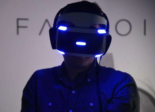 A man tries the new Sony VR headset at the E3 video game gathering in Los Angeles, California on June 13, 2016