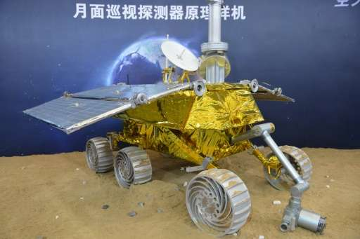 A model of a lunar rover known as The Yutu, or Jade Rabbit, seen on display at the China International Industry Fair in Shanghai