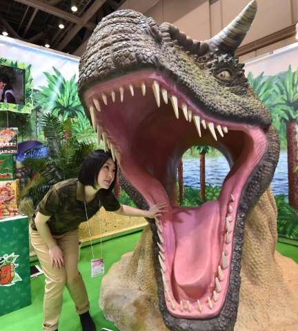 A model of giant dinosaur is displayed at the Tokyo Toy Show on June 10, 2016
