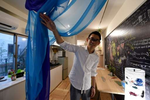 An Airbnb host displays his guest room at his room in Tokyo, but the site's fastest-growing market is also becoming the next fla