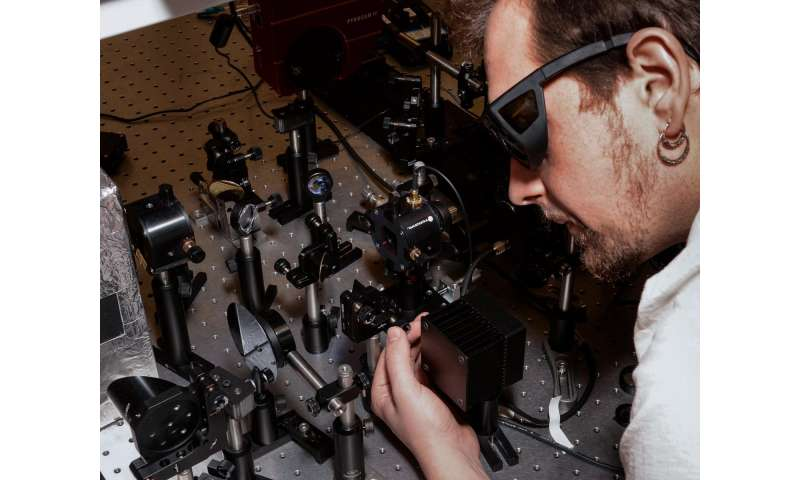 Andrei Gorodetsky adjusts the optical system