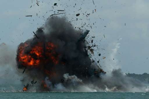 An impounded fishing boat is blown up in Batam, Kepulauan Riau province on February 22, 2016
