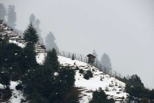 An Indian security border post is seen in the snow-covered Neelum Valley, as seen from Pakistan-held Kashmir