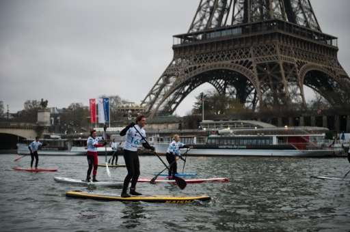 A paddle-boat race takes place on the River Seine in Paris