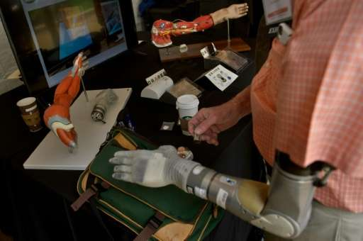 Army (Ret.) Lieutenant Fred Downs, who lost his arm to a land mine while serving in the Vietnam War, uses his robotic hand that
