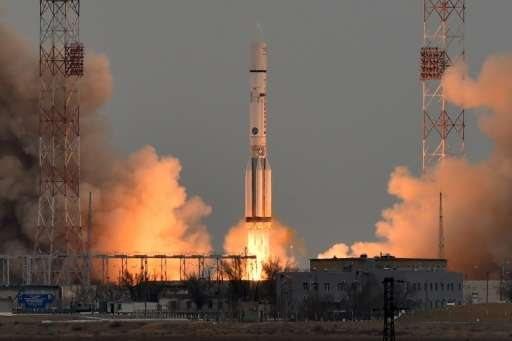 A Russian Proton-M rocket carrying the ExoMars 2016 spacecraft blasts off from the launch pad at the Russian-leased Baikonur cos