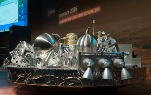 A scale model of the Schiaparelli landing unit that will scour the Red Planet for signs of life