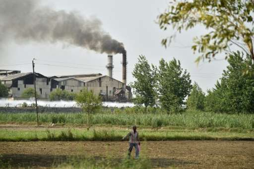 A sugar factory sits on the edge of the village of Gangnauli, in India's northern state of Uttar Pradesh