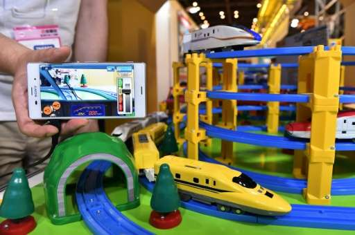 A toy train is equipped with a camera to show the view from the cockpit, during a demonstration by Tomy at the Tokyo Toy Show on