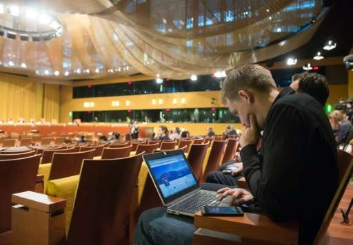 Austrian Max Schrems waits for a verdict at the European Court of Justice in Luxembourg on October 6, 2015 over claims that his