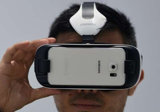 A visitor tests a Samsung Gear VR during the opening day of the 2015 Mobile World Congress in Barcelona on March 2, 2015