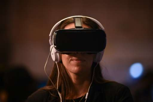 A Websummit attendee tries a virtual reality goggles during the Web Summit at Parque das Nacoes, in Lisbon on November 10, 2016
