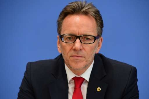 """BKA chief Holger Muench, pictured in 2015, said police were taking a """"clear stance against hate and incitement on the inter"""