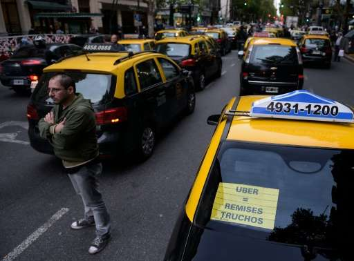 Cabs block Mayo Avenue as taxi drivers protest against Uber and what is viewed by some drivers as unfair competition in Buenos A
