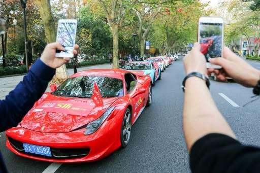 Car maker Ferrari faces a fine for exceeding its carbon emissions target
