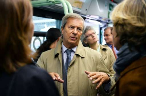 Chairman and CEO of French industrial group Bollore Group, Vincent Bollore, rides on a bus in Paris, in May 2016