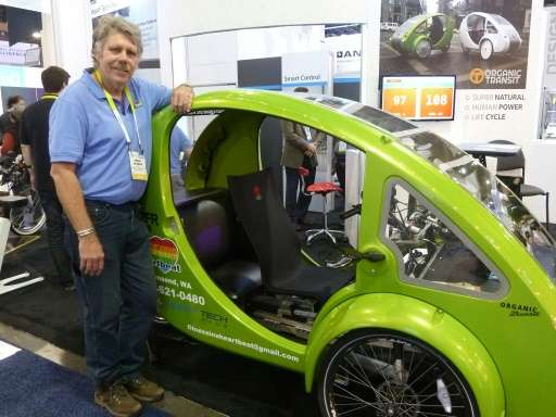 Craig Sparks of Organic Transport shows the Elf solar- and pedal-powered vehicle touted as the world's most environmentally frie