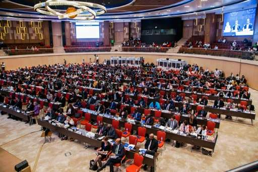 Delegates attend the official opening of the 28th meeting of the Parties to the Montreal Protocol in Kigali on October 13, 2016