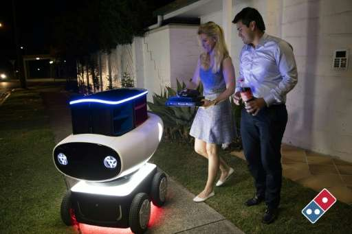 Domino's new trial pizza delivery robot in New Zealand is just under a metre (three foot) high and contains a heated compartment
