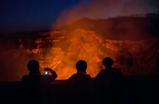 Each tourist's visit to the volcano is limited to just a few minutes because of the risk from toxic gases
