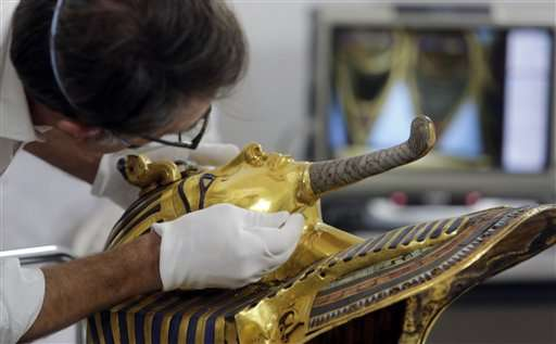 Egypt says King Tut mask was scratched, sends 8 to trial