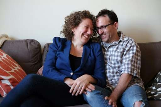 Emily Helfgot and her husband Robert Weinstein, who met each other through an online dating website, pose in their apartment in