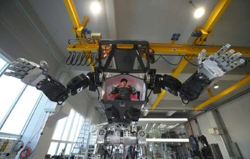 Engineers test a four-metre-tall robot dubbed Method-2 at a lab in Gunpo, on December 27, 2016