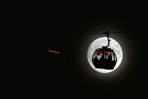 Experts recommend people choose somewhere with a well-known landmark in the foreground to get the best view of the 'supermoon'