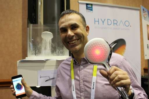French engineer Gabriel Della-Monica on January 4, 2016 at the Consumer Electronics Show in Las Vegas, with a smart showerhead t