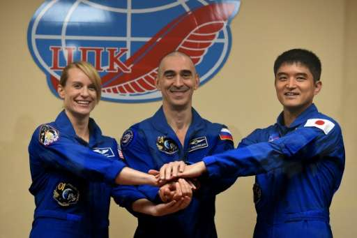 (From L) Members of the main crew of the International Space Station Expedition 48/49, astronauts Kate Rubins, Anatoly Ivanishin