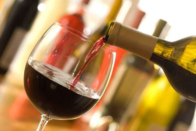 Greater alcohol use may reduce heart attacks, increase atrial fibrillation