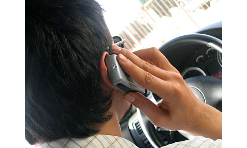 Hands-free just as distracting as handheld mobile phone use behind the wheel