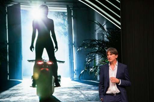 Head of BMW Motorrad Design, Edgar Heinrich, speaks at the unveiling of the BMW Motorrad VISION NEXT 100 concept motorcycle at t