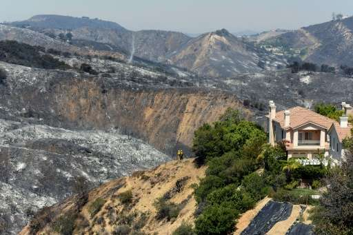 Hills burnt from a wildfire surrounding a home on Ganelon Drive on June 5, 2016 in Calabasas, California, where some 5,000 peopl