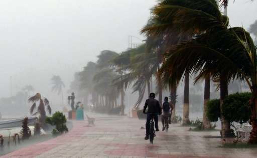 Hurricane Newton, since downgraded to a tropical storm, left two people dead as it roared across Mexico's northwestern Baja Cali
