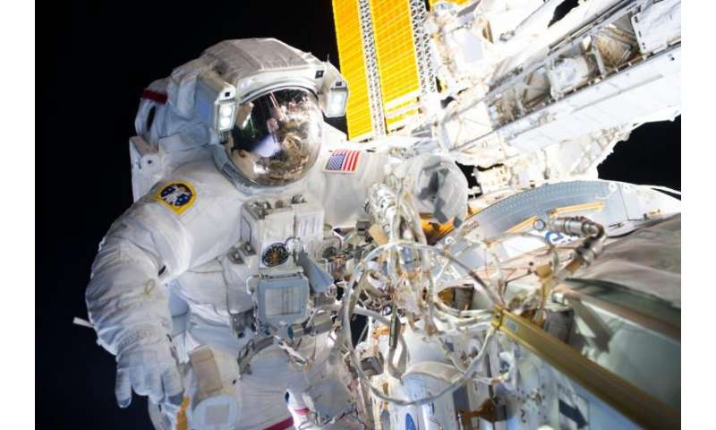 Image: Spacewalkers successfully install new docking adapter for commercial crew flights