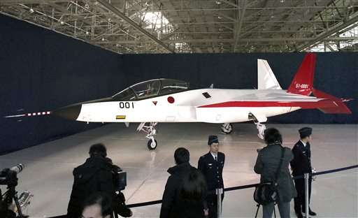 Japan unveils stealth plane, may combine with next-gen jet