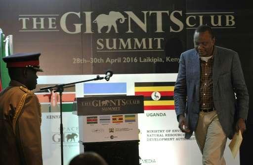 Kenya's President Uhuru Kenyatta arrives at the opening session of the anti-poaching Giants Club Summit in Nanyuki on April 29,