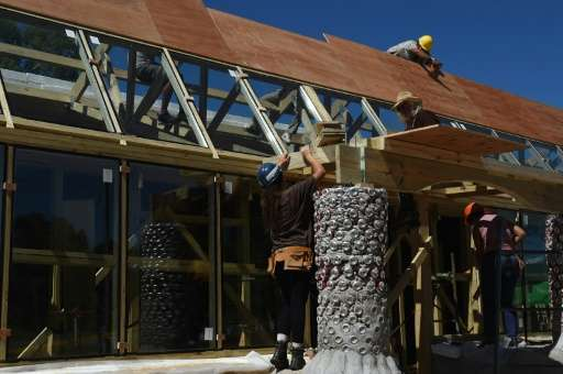 Made of tires and glass and plastic bottles an elementary school in Jaureguiberry, east of Montevideo, claims to be the first pu