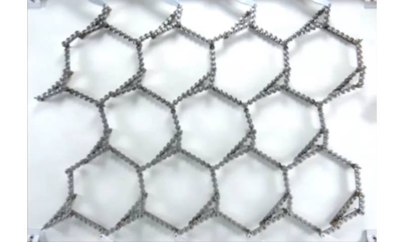 Metamaterial built from gears