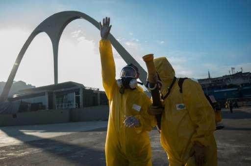 Municipal agents prepare to spray anti-Zika mosquitos chemical product at the sambadrome in Rio de Janeiro