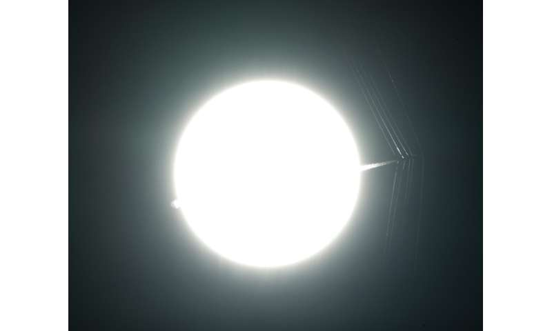 NASA image: T-38C Passes in Front of the Sun at Supersonic Speed