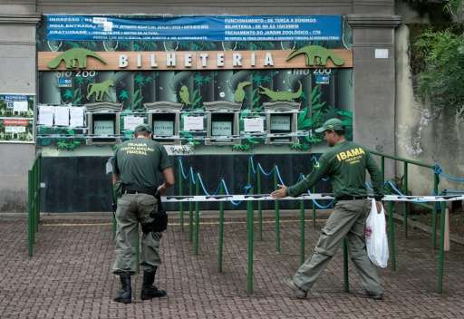 National Institute of Environment personnel close Rio de Janeiro's Zoo on January 14, 2016 while staff carry out improvements to